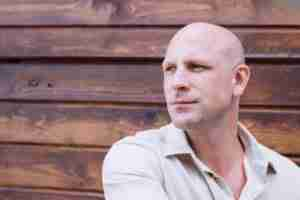 portrait of handsome bald man cancer survivor